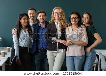 Feminino representante companhia indicação sorridente Foto stock © stockyimages