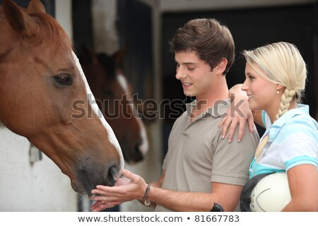 Two teenagers stood by horse stable Stock photo © photography33