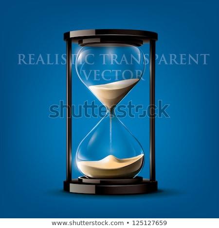 ストックフォト: Hour Glass With Old Money