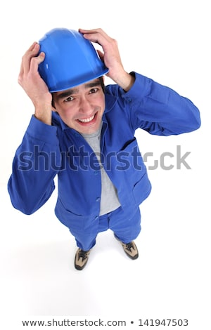 craftsman in panic holding his helmet Stock photo © photography33