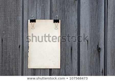 black clip and old blank note paper hang on wood panel  Stock photo © inxti