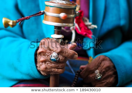 bell and prayer wheels in nepal Stock photo © gewoldi