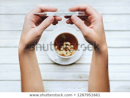 Stock photo: hand holding up the number six from the top