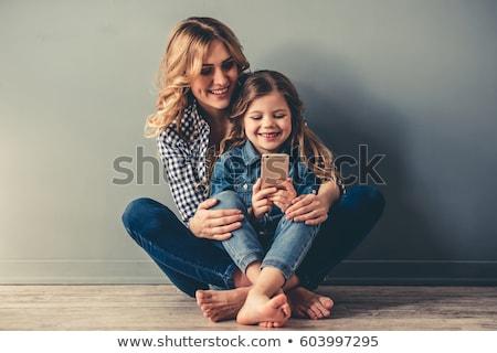 Mooie jonge blond twee telefoons portret Stockfoto © acidgrey