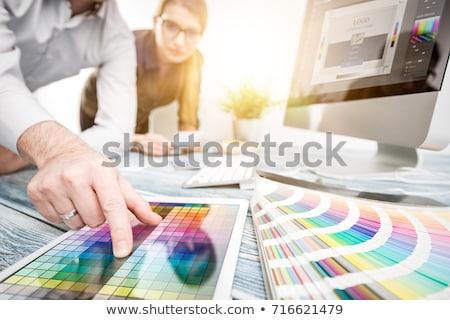 Stock photo: Designer at work. Color samples.