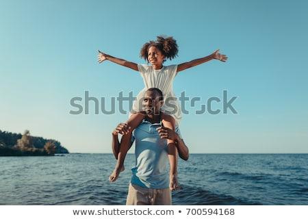 Apa tart lánygyermek karok tengerpart fiatal Stock fotó © ElinaManninen