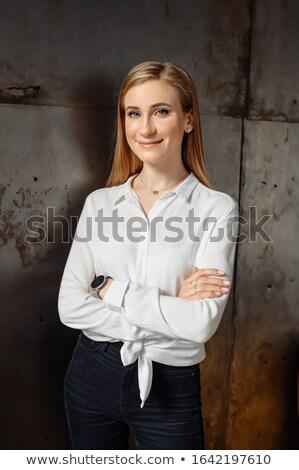 Vonzó üzletasszony keresztbe tett kar fehér nő mosoly Stock fotó © rozbyshaka