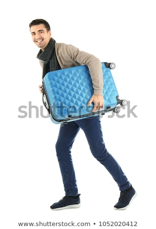 A young man carrying a suitcase stock photo © Andersonrise