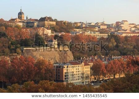 Lyon outono pôr do sol passarela cidade sol Foto stock © vwalakte