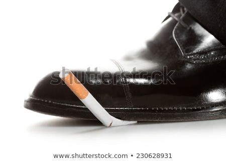 Boot treading cigarette tobacco addiction Stock photo © lunamarina