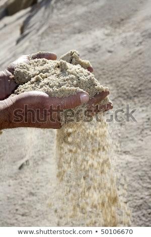 gravel sand in man hands in quarry background stock photo © lunamarina