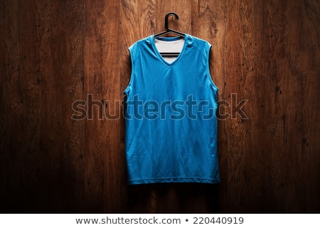 Basketball uniform hanging in a locker Stock photo © zzve