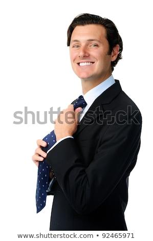 Businessman adjusting his tie smiling Stock photo © Rugdal