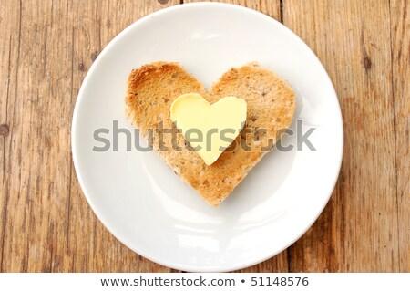 Kalp tereyağı tost iki dilimleri Stok fotoğraf © Tagore75