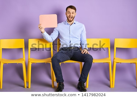 laughing young casual man sitting stock photo © feedough