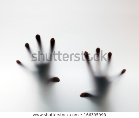 Hands touching frosted glass. Conceptual scream for help Stock photo © photocreo
