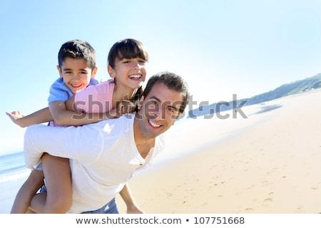 Père en fils jouer ferroutage plage heureux été Photo stock © monkey_business