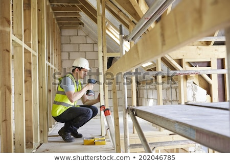 Construction Worker Using Drill On House Build Stock photo © HighwayStarz
