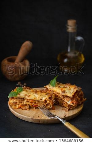 Cucina italiana lasagna piatto tavolo in legno caldo gustoso Foto d'archivio © dariazu