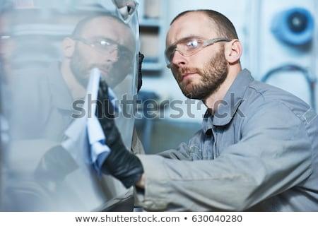 Mechanic inspecting damaged car Stock photo © photography33