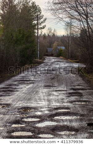 dirty broken rural road stock photo © nneirda