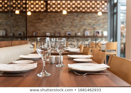 table setting glasses and plates on table in a restaurant stock photo © amok