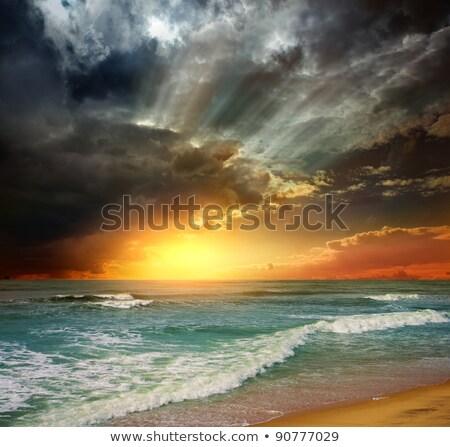 Epic sunset at the sea coast Stock photo © dariazu