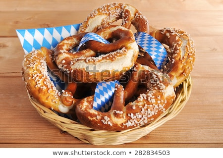 Wooden boards with a bavarian diamond pattern and pretzels Stock photo © Zerbor