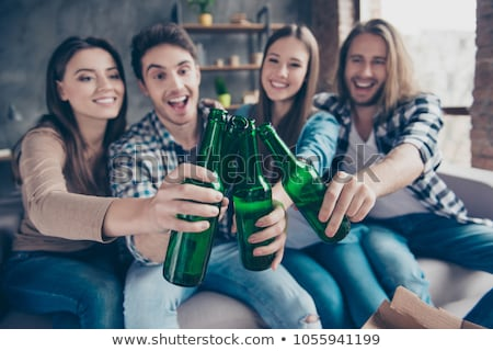 four hands with the bottles of the beer 2 stock photo © paha_l