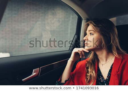Beautiful young executive sitting in limousine Stock photo © dash