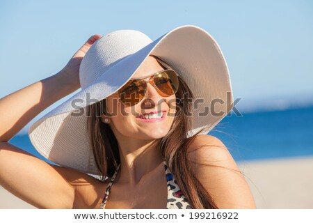 Elegant beachwear bikini woman with hat sunglasses Stock photo © Maridav
