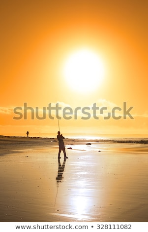 lone fisherman fishing on the sunset Kerry beach Stock photo © morrbyte