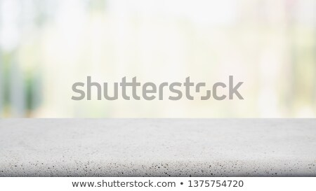 Concrete table top with abstract blur coffee shop Stock photo © punsayaporn