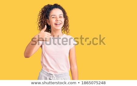 Gyönyörű fürtös kislány áll mutat remek Stock fotó © deandrobot