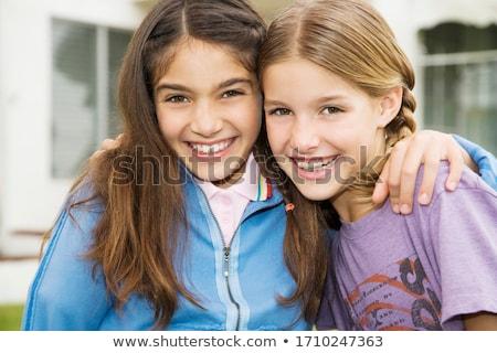 Dwa dziewcząt uśmiech kobiet para komórkowych Zdjęcia stock © Andersonrise