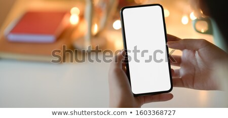 Close-up shot of blank screen of smartphone Stock photo © deandrobot