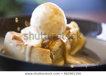 Stock photo: Scoops of ice cream with puff pastry biscuit
