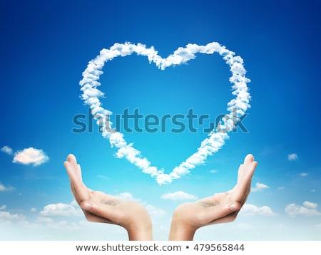 kéz · tart · szív · alak · felhő · kék · ég · természet - stock fotó © rufous
