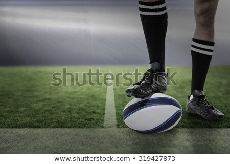 Low section of rugby player holding ball on field Stock photo © wavebreak_media