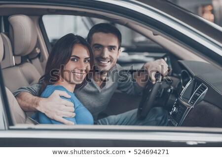 Jóvenes sonriendo Pareja sesión frente coche nuevo Foto stock © deandrobot