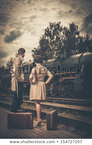 young attractive fashion lady on railway station waiting vintag stock photo © iordani