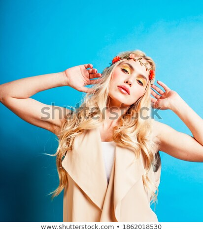 young blond woman dressed like ancient greek godess gold jewelry close up isolated beautiful girl stock photo © iordani