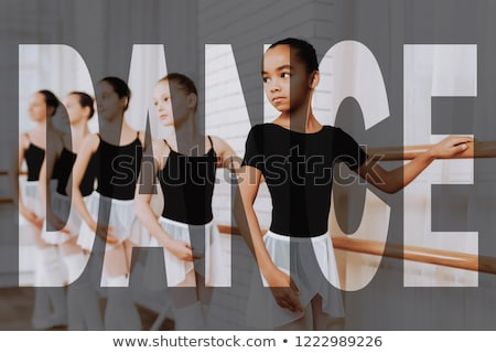 young ballet dancer wearing black transparent dress dancing stock photo © julenochek