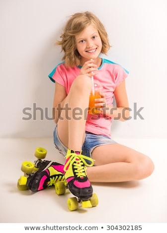 Csinos boldog lány ül padló fehér boldog Stock fotó © julenochek