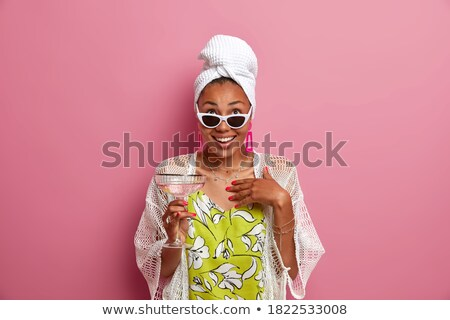 concentrated young lady wearing sunglasses posing stock photo © deandrobot