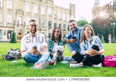 group of young people sitting on lawn stock photo © is2