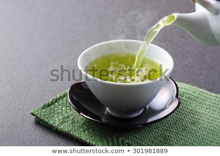 Кубок зеленый чай украшенный чай листьев Сток-фото © blackmoon979