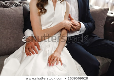 The groom gently holds the bride by the hand Stock photo © m_pavlov
