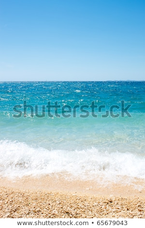 Sea view pebble beach and turquoise water tranquil scene Stock photo © szabiphotography