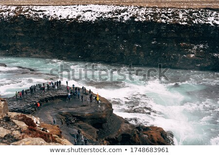 Observation deck with views of the beautiful waterfall in Icelan Stock photo © Kotenko